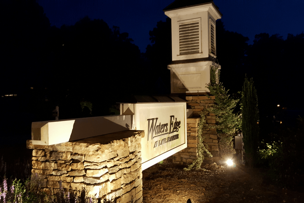 Waters edge entryway lighting for hoa community in greensboro nc