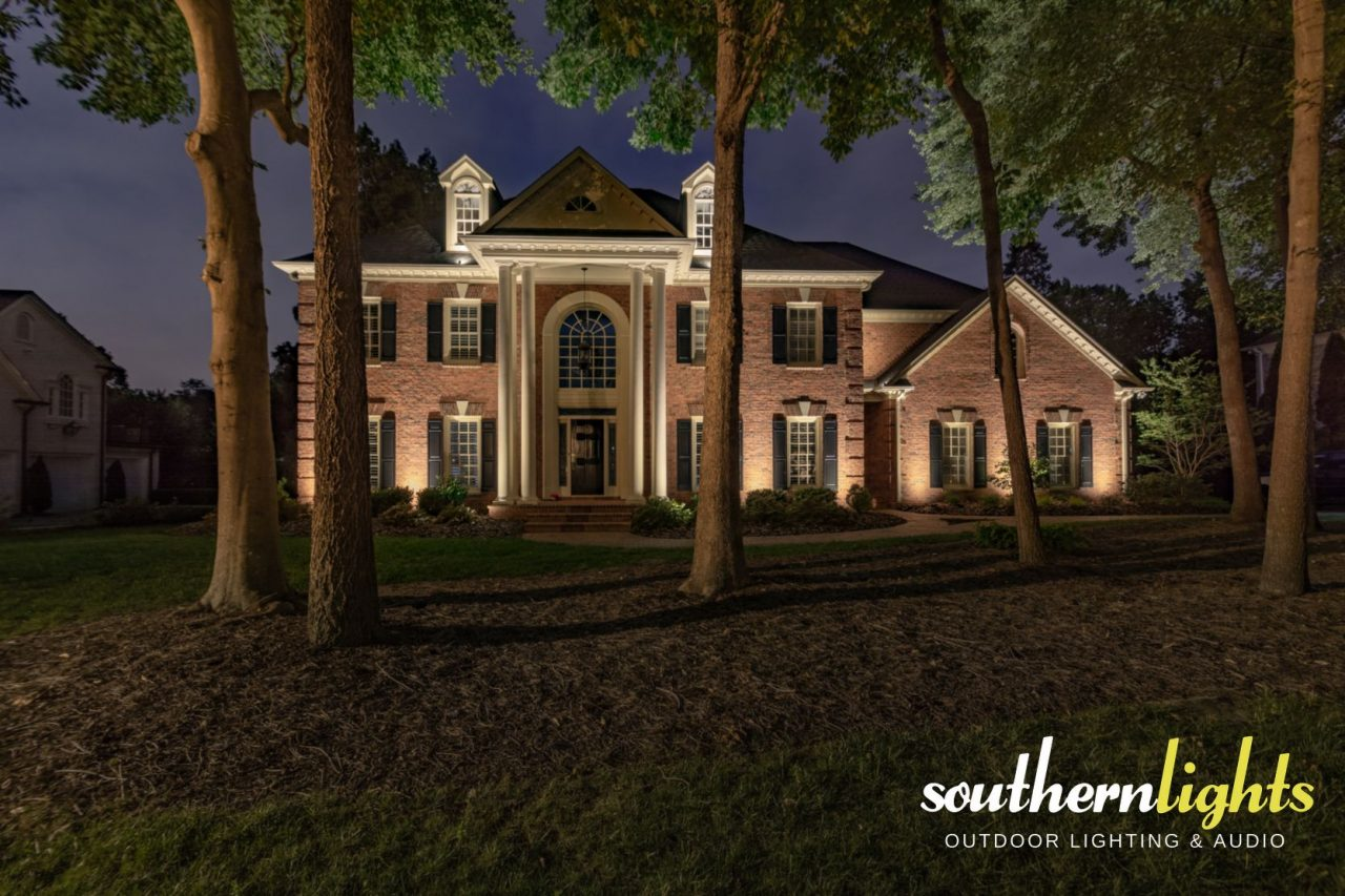 Estate Brick Home Illuminated By Southern Lights Outdoor