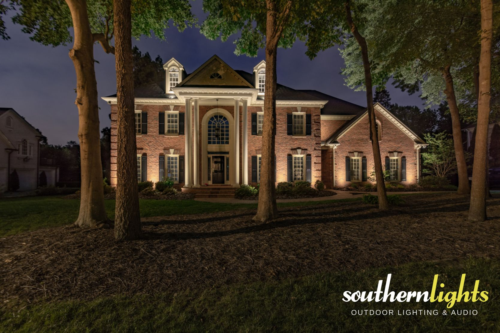 Estate brick home illuminated by southern lights outdoor for Garden lighting design